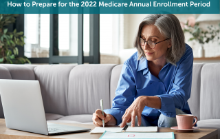 A white senior woman sitting on a grey couch in front of her laptop preparing for the Medicare Annual Enrollment Period